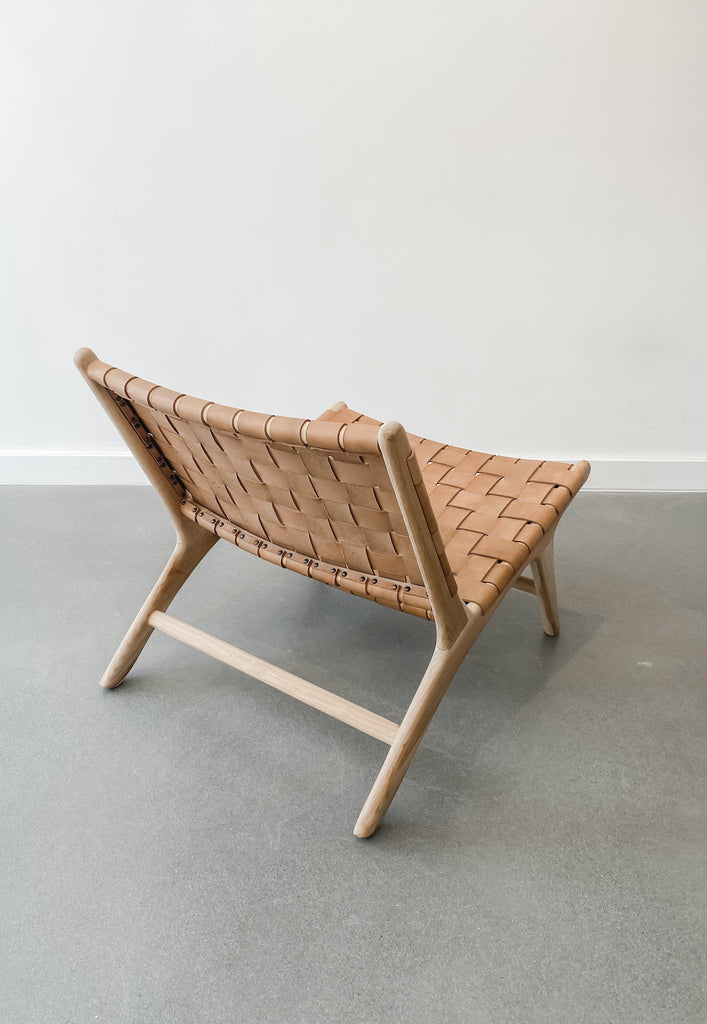 Back view of Woven Leather Strap Lounge Chair in Beige against white background. Teak wood and leather straps. Handcrafted in Bali. - Saffron and Poe