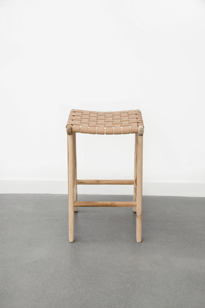 Detailed view of Comfortable, casual, leather-strapped counter height Backless Woven Leather Counter stool in Beige on a white background. Handmade in Bali using Teak wood and vegetable-tanned leather imported from Java. - Saffron and Poe