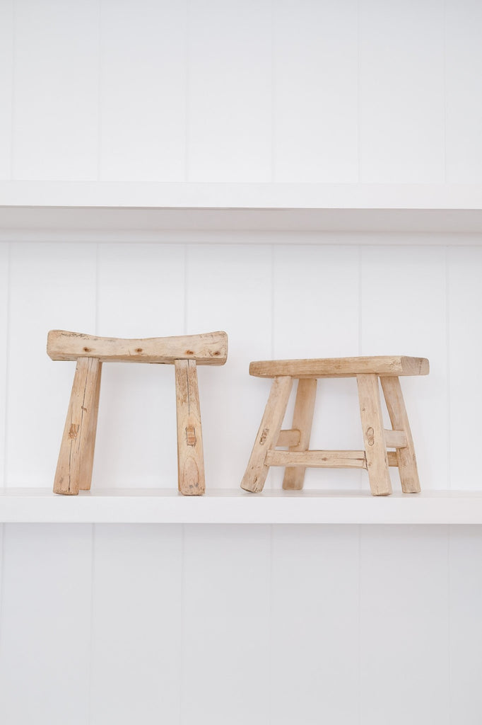 Two petite rectangle stools on white shelf with white background. - Saffron and Poe