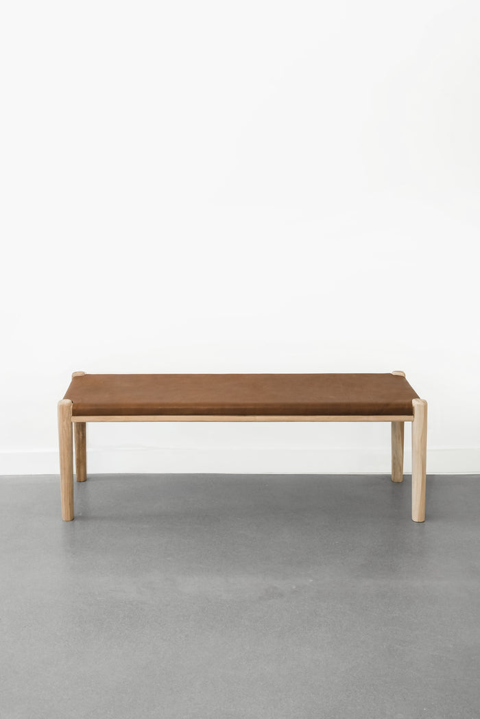 Stretched Teak Leather Bench in Saddle against white background. Furniture handcrafted in Bali.  - Saffron and Poe