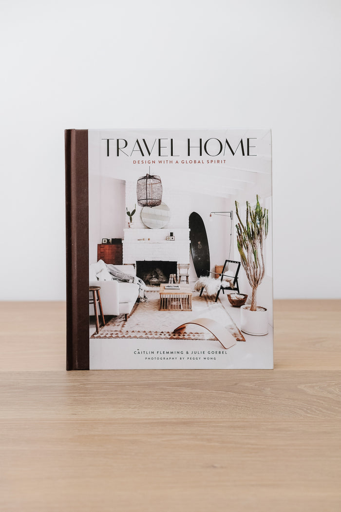 Front view of Travel Home: Design with a Global Spirit against a white wall - Saffron and Poe