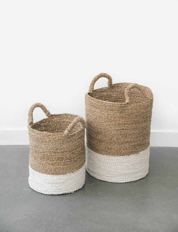 Two cream-colored with white base Structured Hyacinth storage baskets with handles. Handmade in Bali using natural water hyacinth  - Saffron and Poe