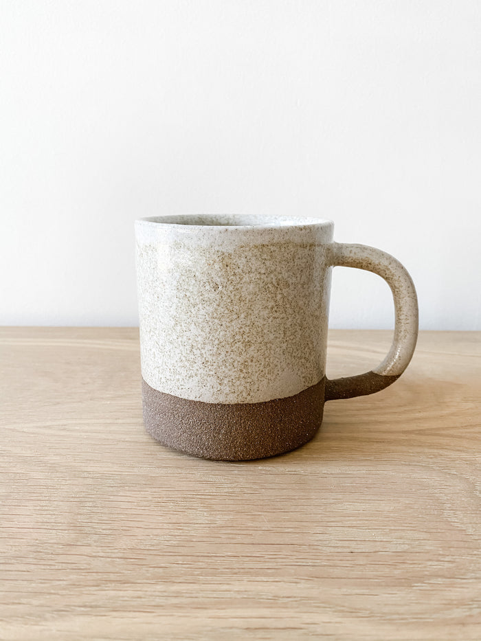 Front view of Uzumati Ceramic Snow Creek Mug on white oak against a white wall - Saffron and Poe