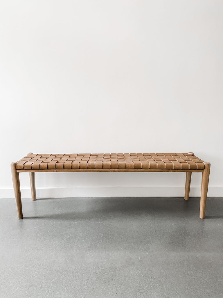 "Front view of 60"" woven leather strap bench in beige against white background. Handcrafted in Bali. Teak wood and leather straps. - Saffron and Poe"