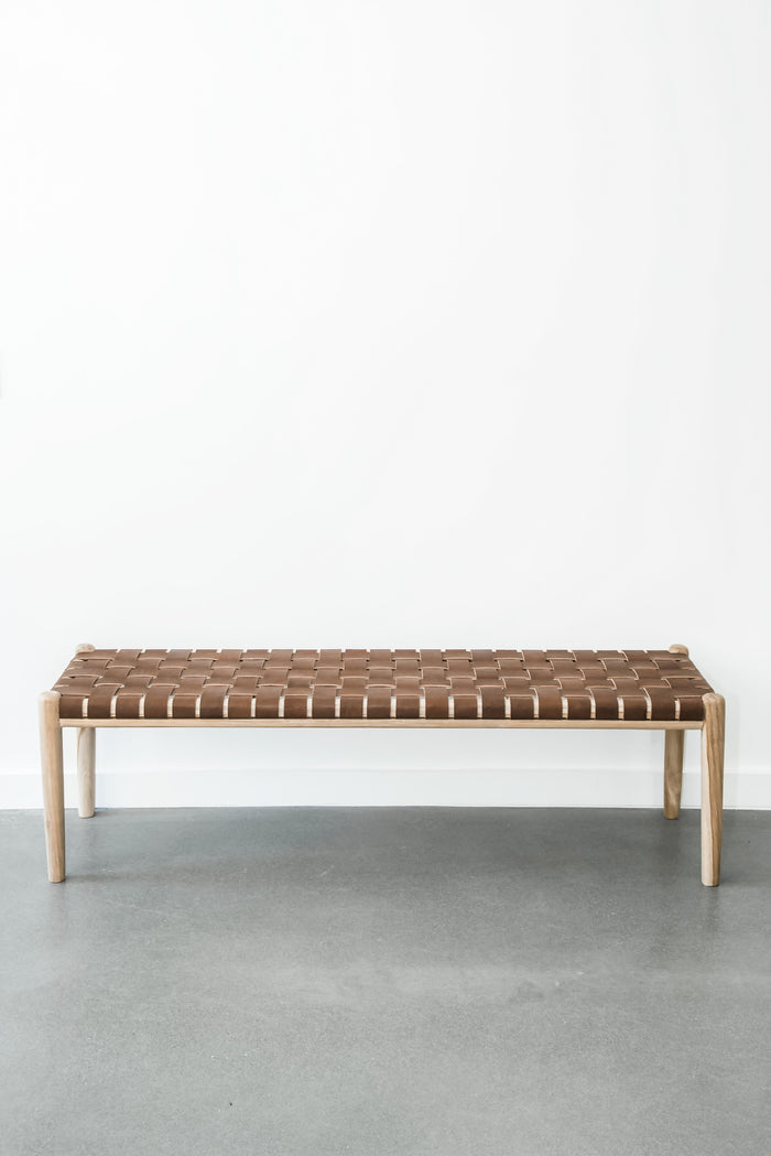 Teak framed Woven Leather Strap Bench against white wall background. Furniture Handcrafted in Bali.- Saffron and Poe