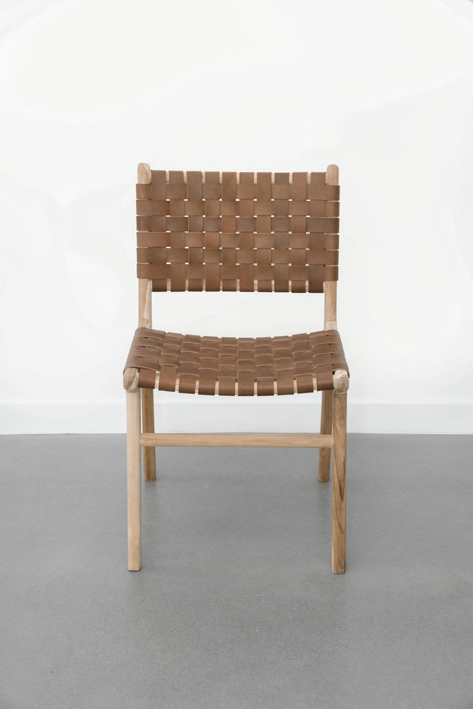 Front view of our Woven Leather Strap Dining Chair - Saddle. Handmade in Bali with Teak wood and vegetable-tanned leather imported from Java. - Saffron and Poe