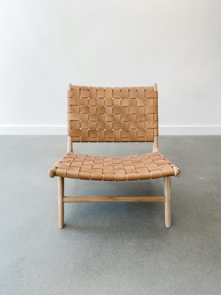 Front view of Woven Leather Strap Lounge Chair in Beige against white background. Teak wood and leather straps. Handcrafted in Bali. - Saffron and Poe