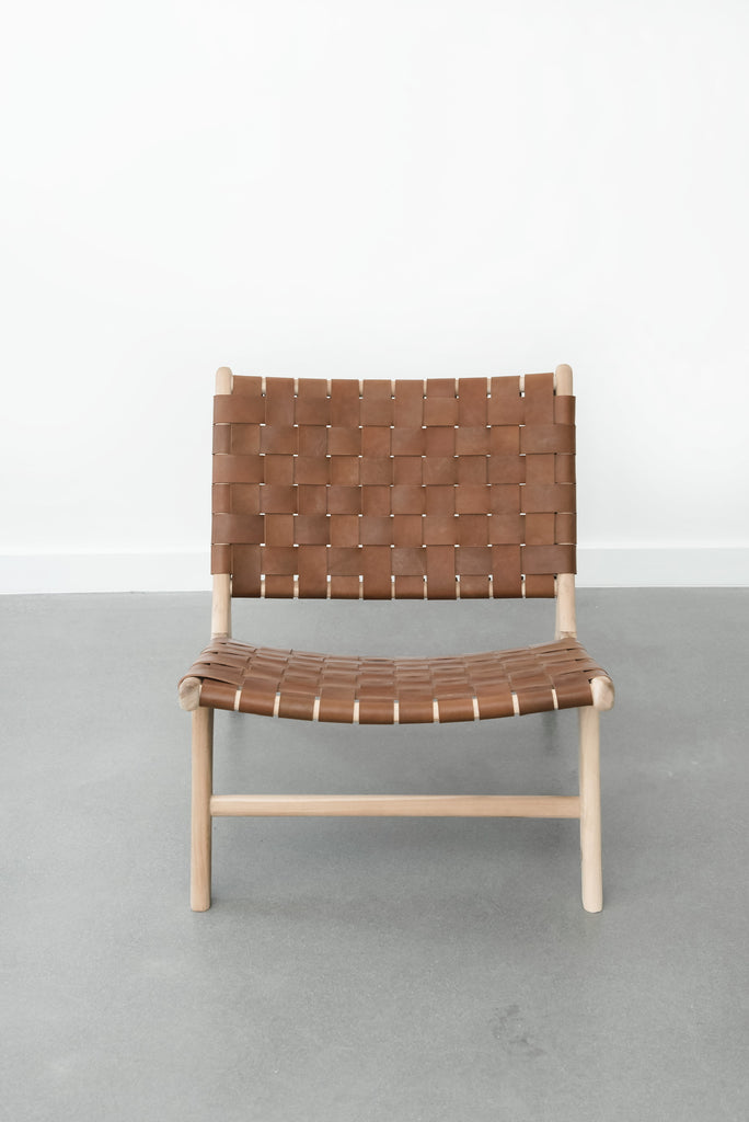 Front view of Woven Leather Strap Lounge Chair - Saddle on white background. Handmade in Bali with Teak wood and vegetable-tanned leather imported from Java. - Saffron and Poe