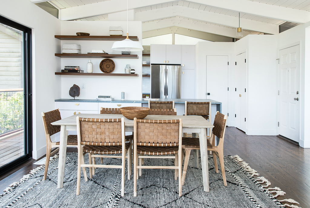 White open kitchen farmhouse table styled with Woven Leather Strap Dining Chair - Saddle. Handmade in Bali with Teak wood and vegetable-tanned leather imported from Java. - Saffron and Poe