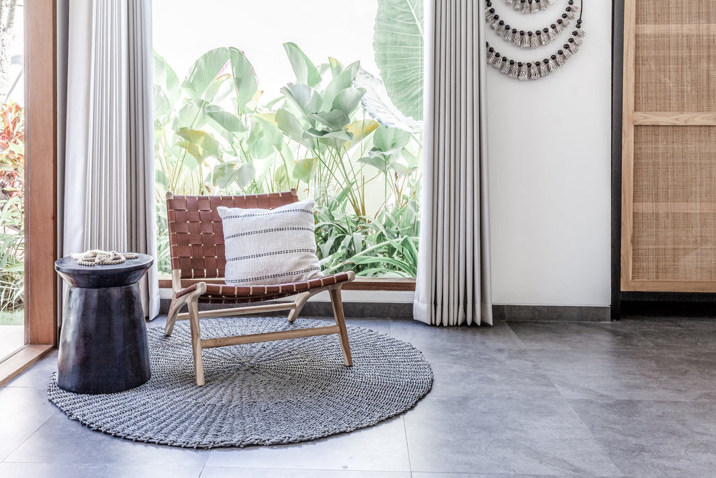 Woven Leather Strap Lounge Chair - Saddle styled in living room with rug and table. Handmade in Bali with Teak wood and vegetable-tanned leather imported from Java. - Saffron and Poe