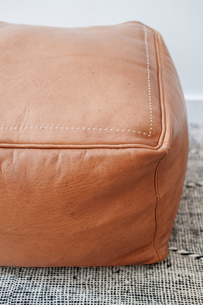 Close up view of Square Leather Moroccan Pouf. - Saffron and Poe