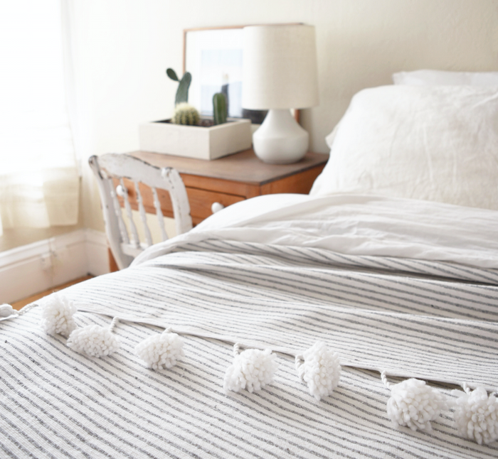 Moroccan Pom Coverlet - Light Grey + White Stripe - SaffronAndPoe.com