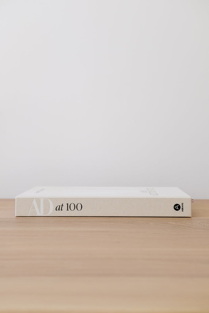 Side view of Architectural Digest at 100 against a white wall - Saffron and Poe