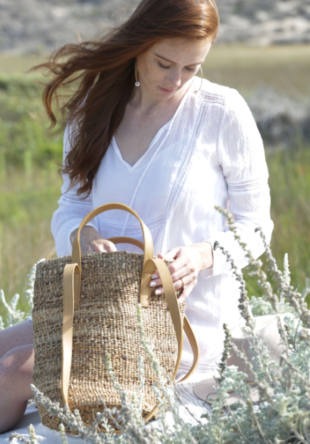 Casual Natural Sisal and Leather Multi Strap Tote handcrafted bag from Kenya on model at beach. - Saffron and Poe