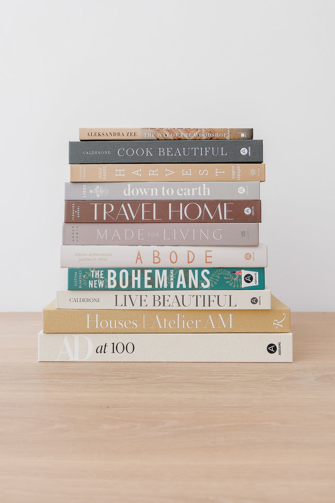 Architectural Digest at 100 with stacked book collection - Saffron and Poe
