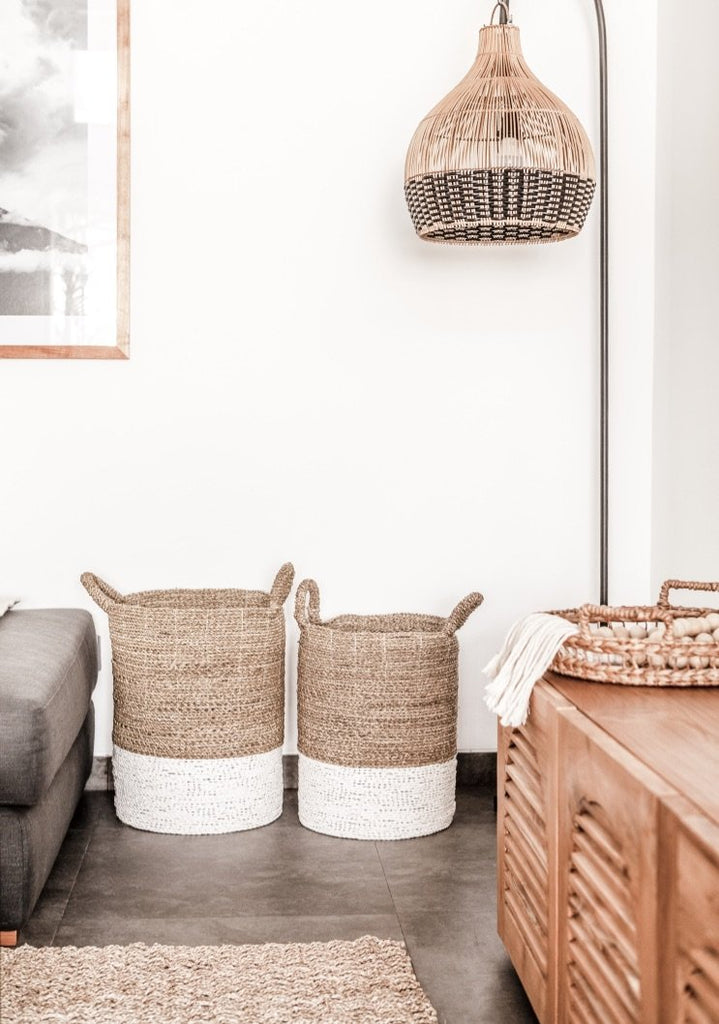 Set of cream-colored with white base Structured Hyacinth storage baskets with handles styled in livingroom. Handmade in Bali using natural water hyacinth  - Saffron and Poe