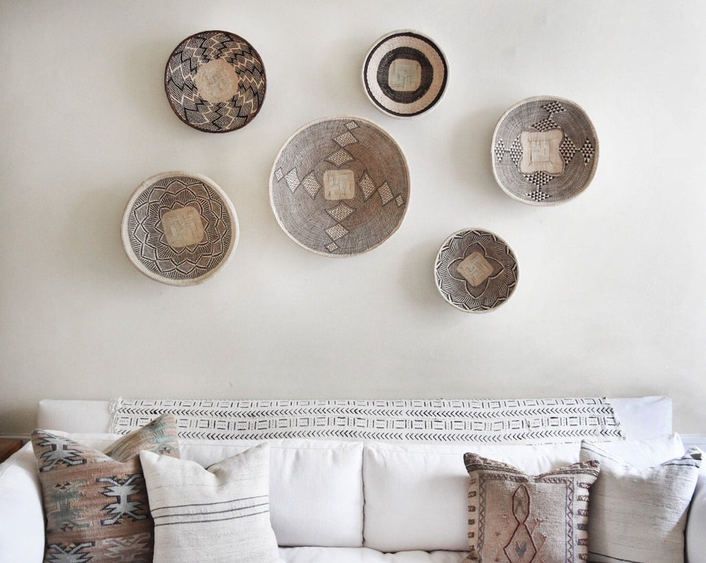 Styled Ilala Wall Baskets over a white sofa. - Saffron and Poe