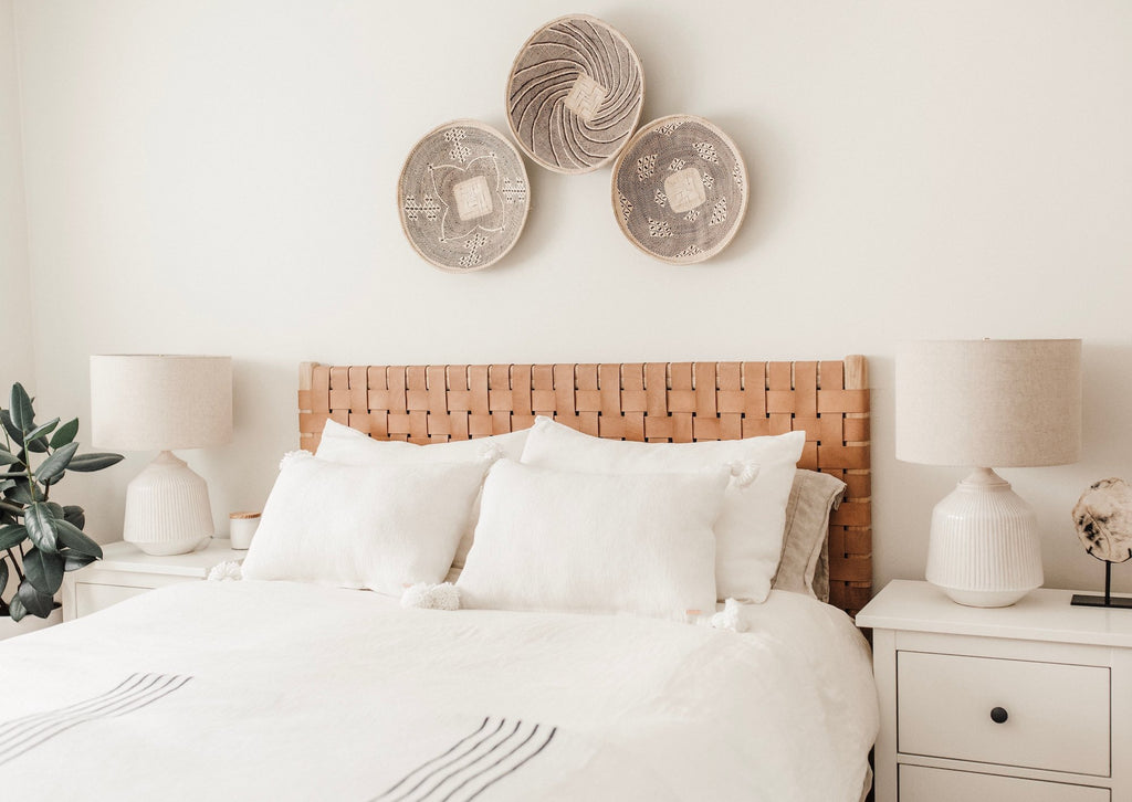 Styled Ilala Wall Baskets over a Woven Leather Strap Headboard. - Saffron and Poe