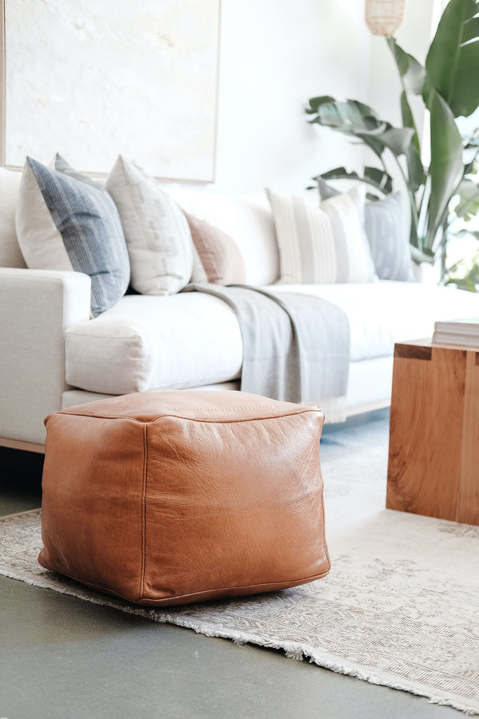 Styled Square Leather Moroccan Pouf in a living room. - Saffron and Poe