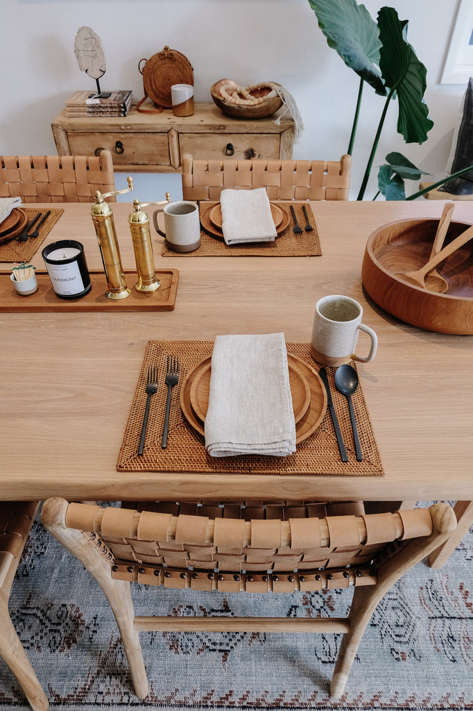 Styled view of Uzumati Ceramic Bodie Mug with Teak Plates and Natural Linen Napkin on Woven Placemat - Saffron and Poe