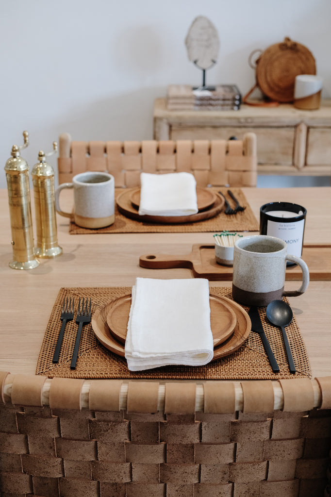 Styled view of Uzumati Ceramic Snow Creek Mug with Teak Plates and an Ivory Linen Napkin - Saffron and Poe