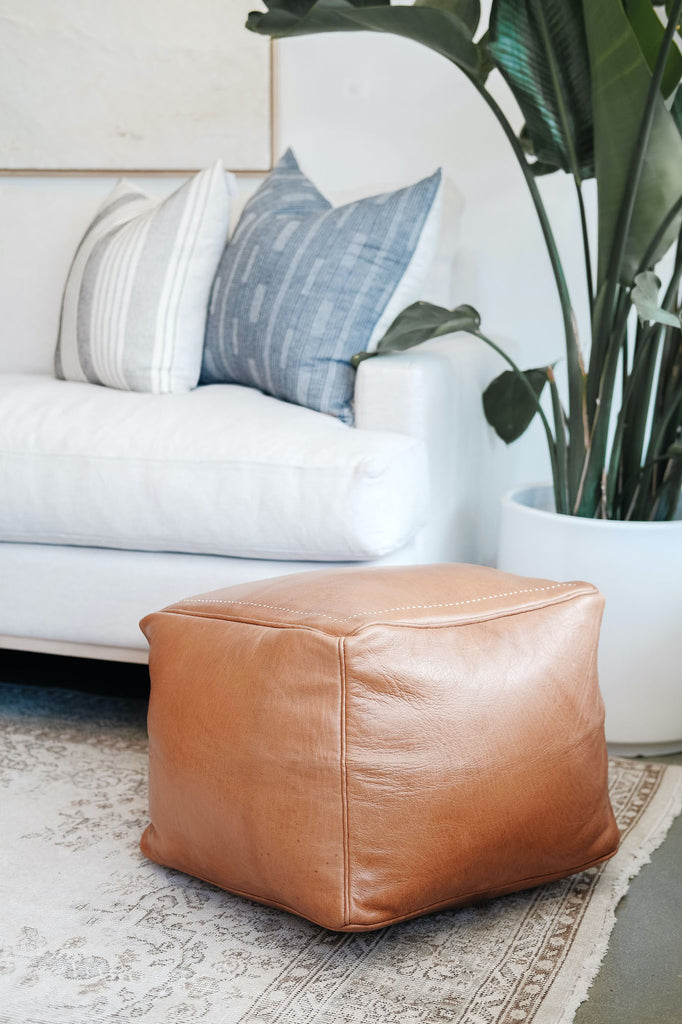 Styled view of Square Leather Moroccan Pouf in a living room with Hmong Hemp Pillows. - Saffron and Poe