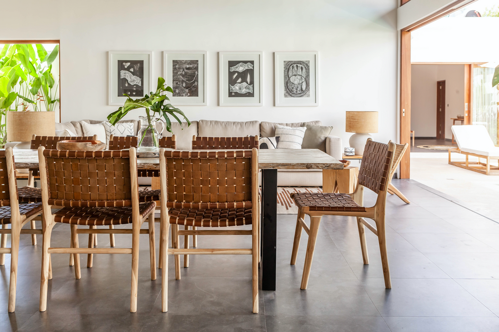 Open living room and kitchen table styled with Woven Leather Strap Dining Chair - Saddle. Handmade in Bali with Teak wood and vegetable-tanned leather imported from Java. - Saffron and Poe