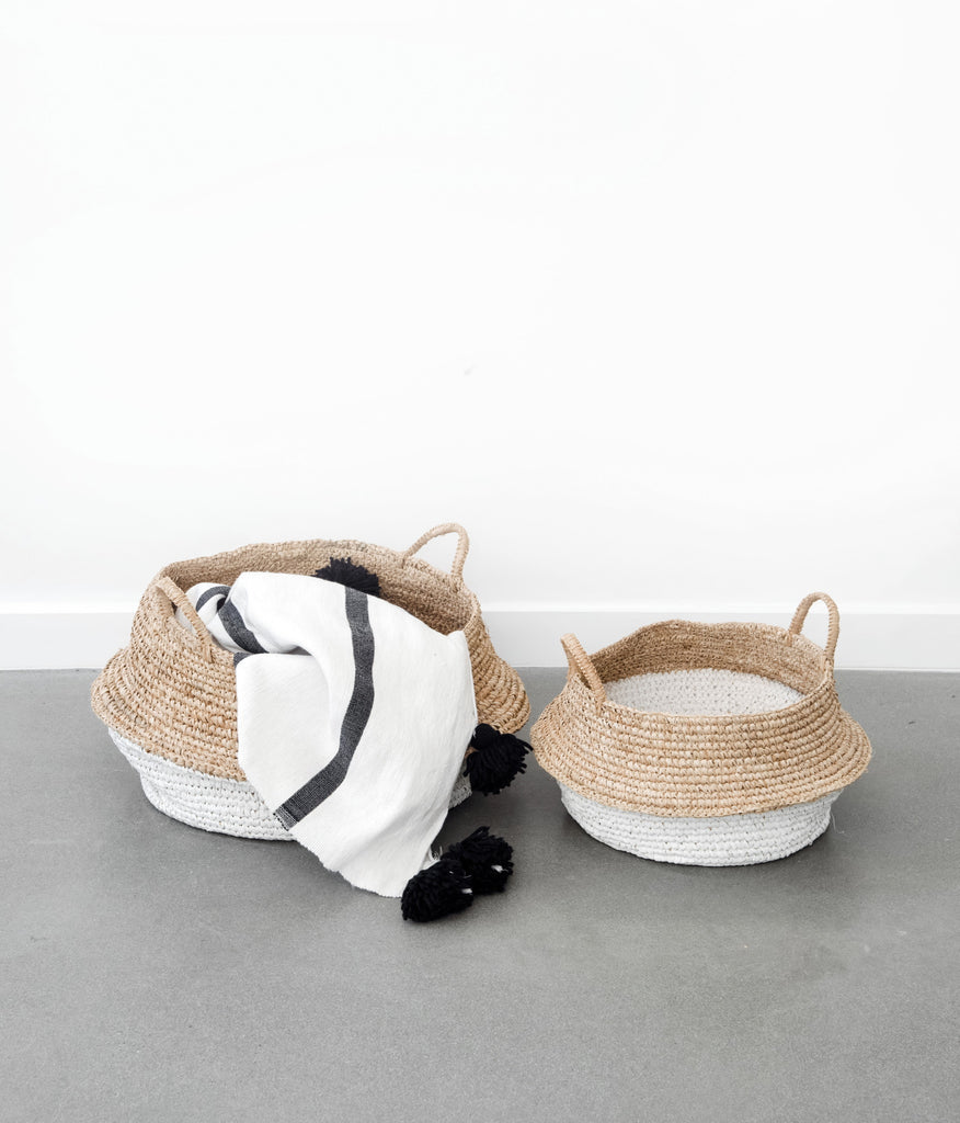 Two collapsible woven Hyacinth Storage Accent Baskets good for blankets, toys, shoes, collapsible, beautiful, and functional with pom throw inside. Handmade in Bali using natural and white painted water hyacinth. - Saffron and Poe