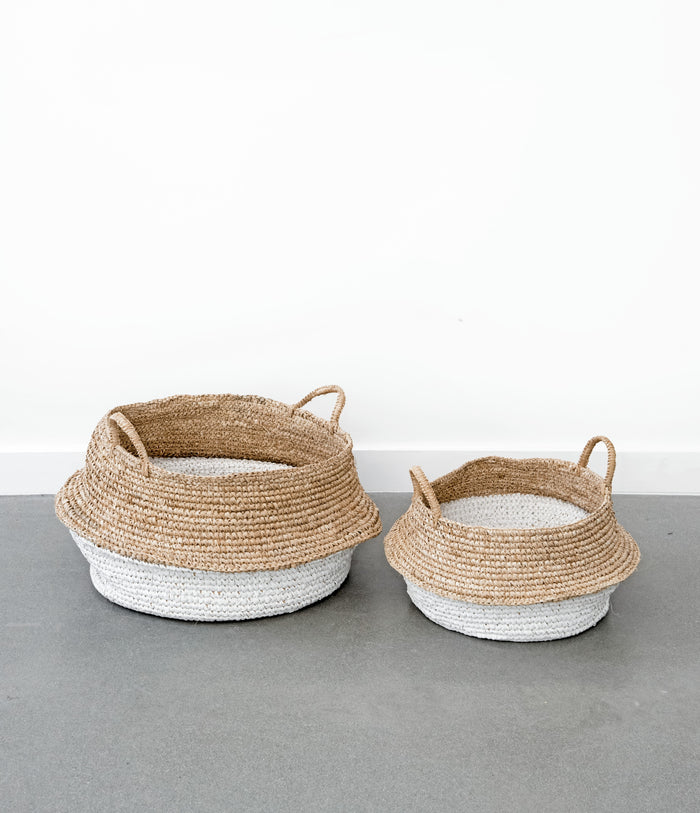 Two of our Collapsible woven Hyacinth Storage Accent Baskets good for blankets, toys, shoes, with blankets. Handmade in Bali using natural and white painted water hyacinth. - Saffron and Poe