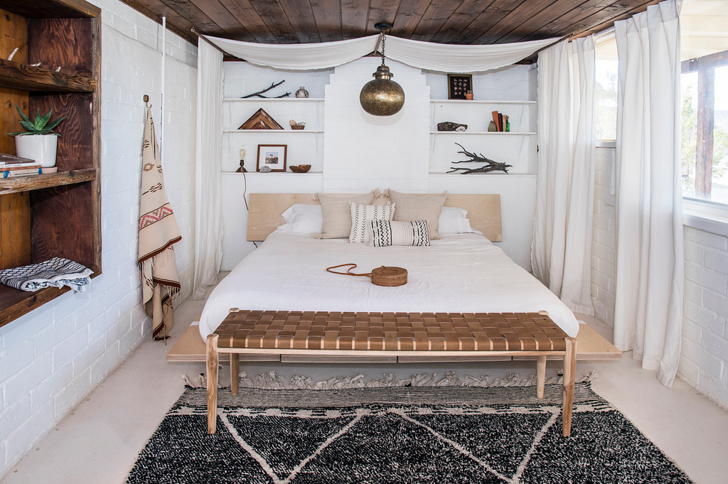 Fully designed Boho bedroom with Teak framed Woven Leather Strap Bench styled at bottom of bed in. Furniture Handcrafted in Bali.- Saffron and Poe