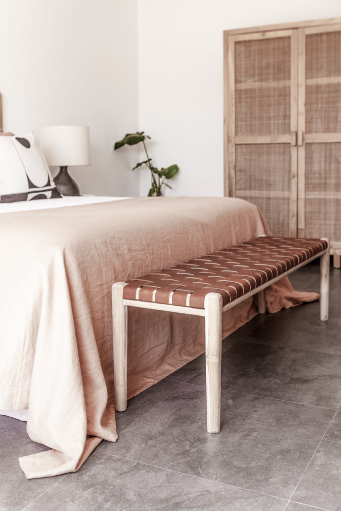 Teak framed Woven Leather Strap Bench styled at bottom of bed in bedroom. Furniture Handcrafted in Bali.- Saffron and Poe