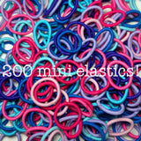 pink, purple, blue ponytail elastics assortment
