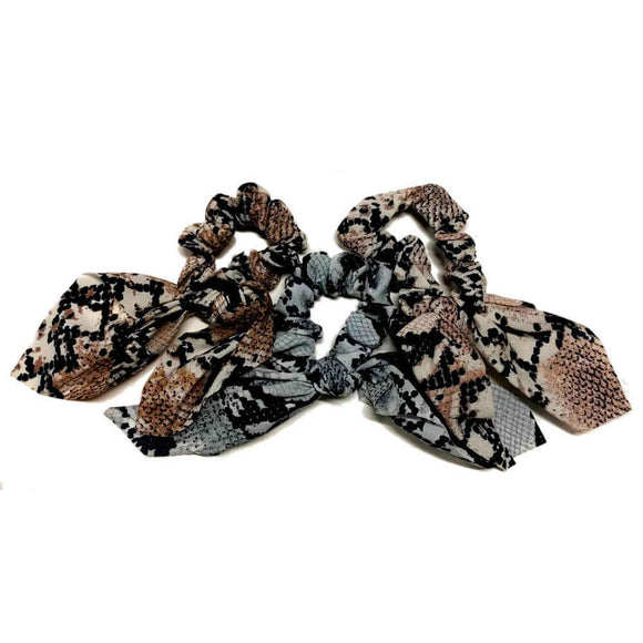 Snakeskin scrunchies with tails