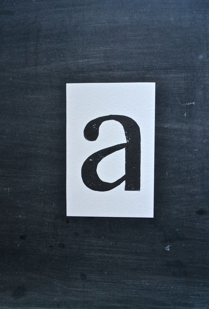 Single Letter Ink Print by Charleston + Co.