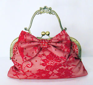 Red lace handbag with bow and antique brass handle, handmade by Rockstars and Royalty