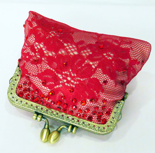 Red lace coin purse with brass frame and red crystals