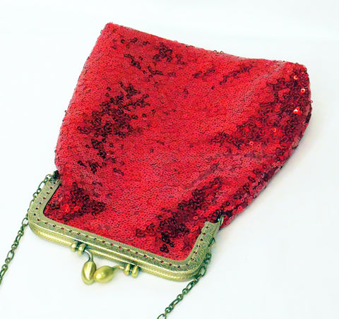 Red sequin pouch bag with brass frame and wrist strap