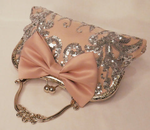 Blush pink satin and silver sequin lace handbag with a bow, silver frame and handle