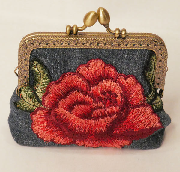 Small denim purse with red rose embroidered applique and antique brass frame