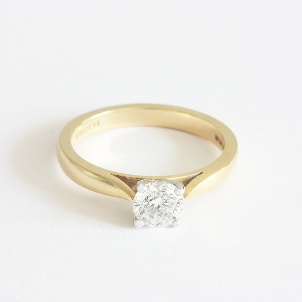 a diamond engagement ring with 4 claw setting and platinum and gold
