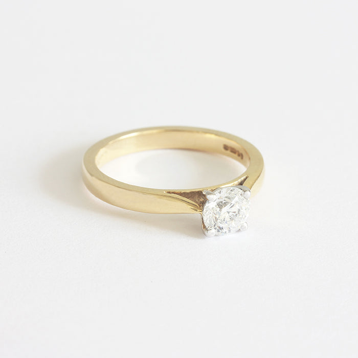 a beautiful diamond solitaire engagement ring in yellow gold and platinum