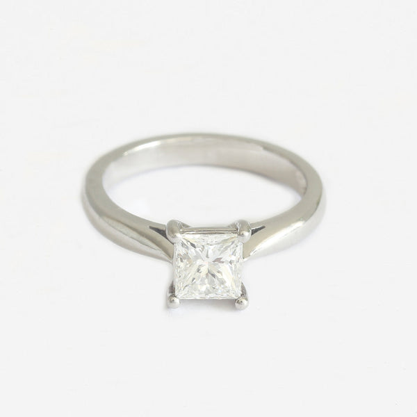 a platinum single stone diamond engagement ring with princess cut stone