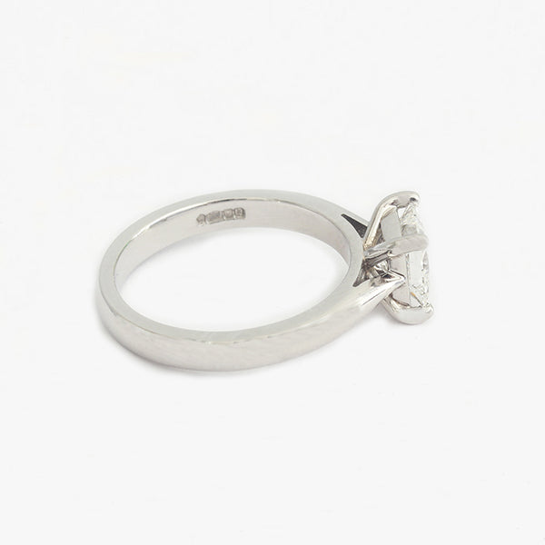 a platinum princess cut diamond solitaire ring with 4 claw settting engagement