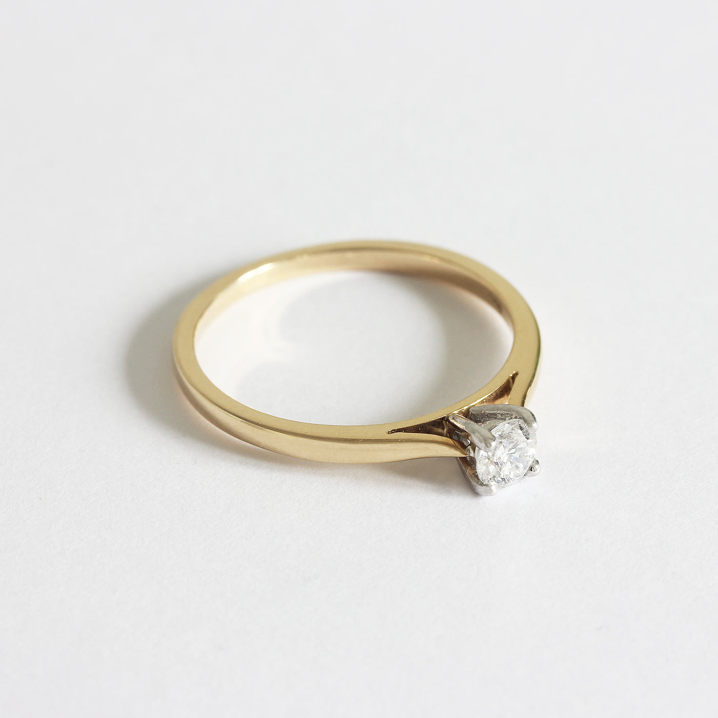 a diamond set engagement ring single stone in white and. yellow gold