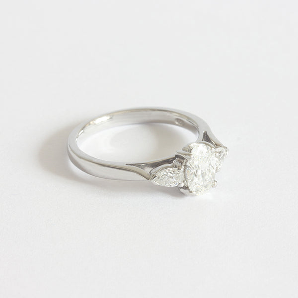 an oval and pear shape 3 stone ring diamond set in platinum