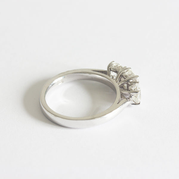 a white gold engagement ring with 3 diamonds in a claw setting