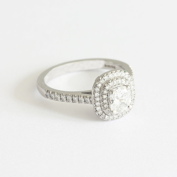 a diamond target cluster ring in platinum with certificate