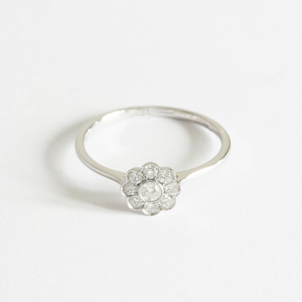 a white gold contemporary daisy design diamond ring