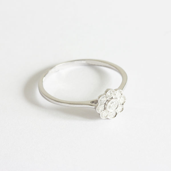 a diamond set daisy ring cluster in white gold