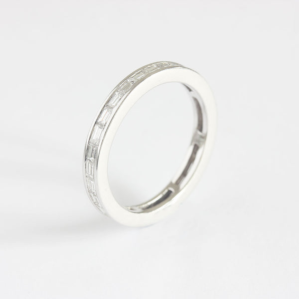 a contemporary white gold eternity ring with baguette cut diamonds
